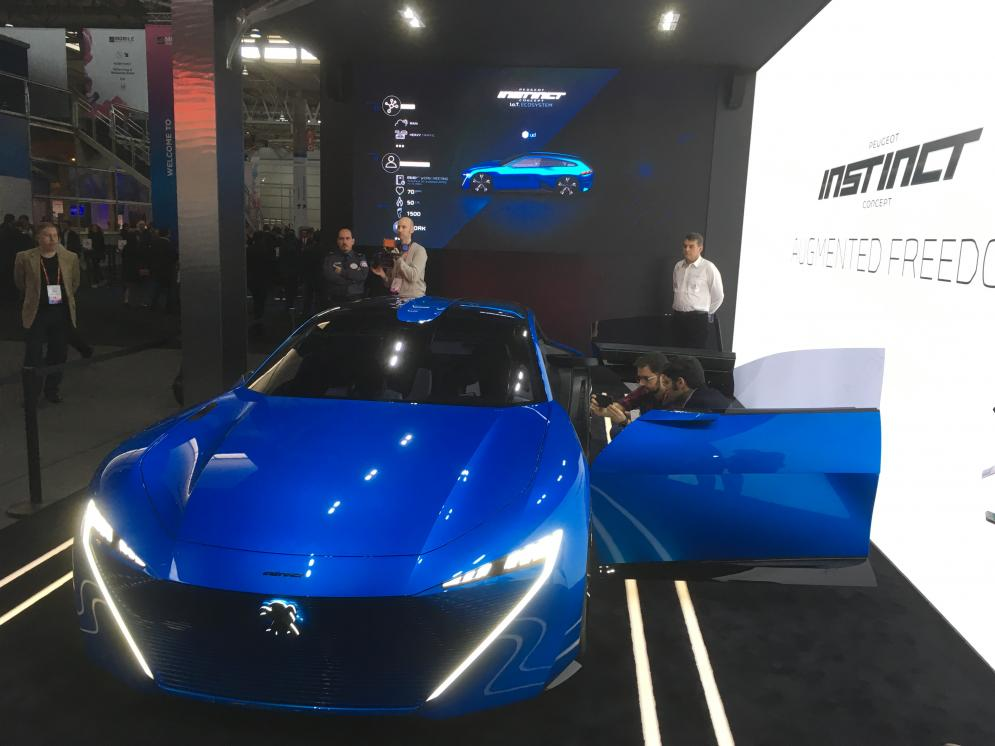 Peugeot showcases 'instinct', its fully autonomous driving car concept, with integration of Internet of Things connected services in partnership with Samsung Artik Cloud.
